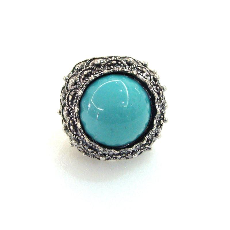 Anel prateado grande pedra azul