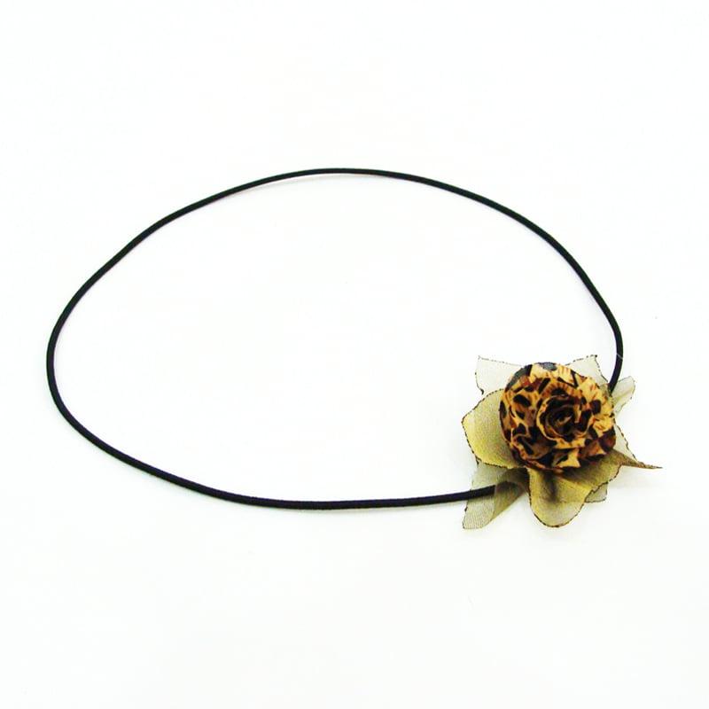 Headband flor oncinha